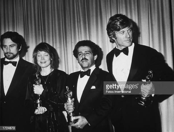 Best Actor winner Robert DeNiro , Best Actress winner Sissy Spacek , Robert L. Schwary, producer of the Best Picture , and Best Director winner...