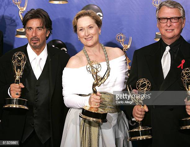 Best Actor winners Al Pacino Meryl Streep and director Mike Nichols winners for Outstanding Miniseries for HBO's Angels in America pose backstage...
