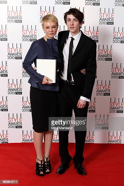 Best Actress Winner Carey Mulligan poses with Matthew Beard in the Winner's room at the ELLE Style Awards 2010 at the Grand Connaught Rooms on...