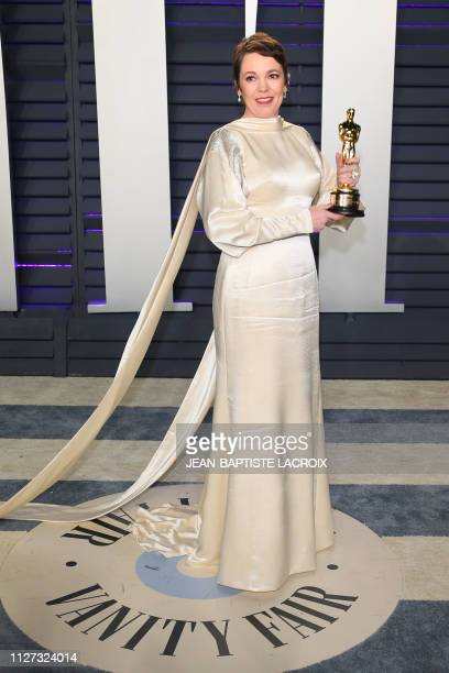 Best Actress winner for The Favourite Olivia Colman poses with her Oscar as she attends the 2019 Vanity Fair Oscar Party following the 91st Academy...