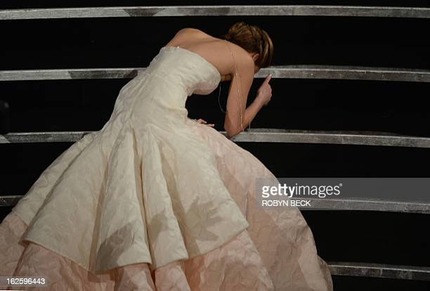 Best Actress winner Jennifer Lawrence falls onstage at the 85th Annual Academy Awards on February 24 2013 in Hollywood California AFP PHOTO/Robyn BECK