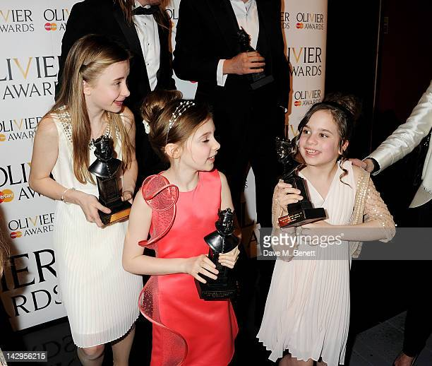 Best Actress winners Eleanor Worthington Cox Kerry Ingram and Cleo Demetriou of Matilda The Musical pose in the press room at the 2012 Olivier Awards...