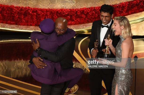 """Best Adapted Screenplay nominee for """"BlacKkKlansman"""" Spike Lee jumps in the arms of Actor Samuel L. Jackson as he accepts the award for Best Original..."""