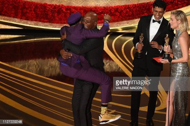 Best Adapted Screenplay nominee for BlacKkKlansman Spike Lee jumps in the arms of Actor Samuel L Jackson as he accepts the award for Best Original...