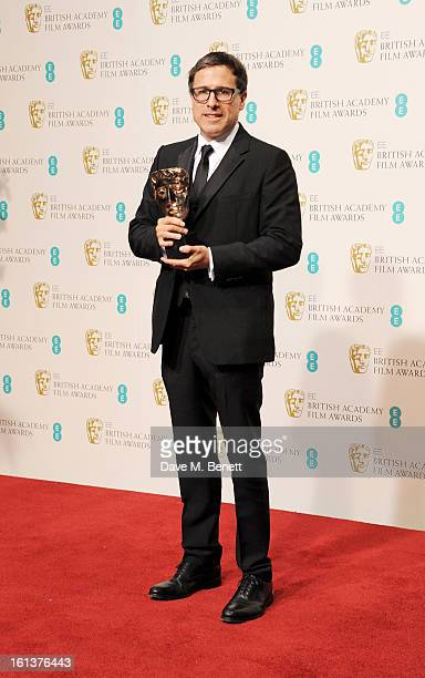 Best Adapted Screenplay winner David O Russell poses in the Press Room at the EE British Academy Film Awards at The Royal Opera House on February 10...