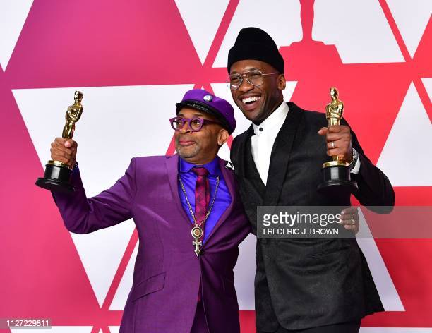 Best Adapted Screenplay winner for BlacKkKlansman Spike Lee and Best Supporting Actor winner for Green Book Mahershala Ali pose in the press room...