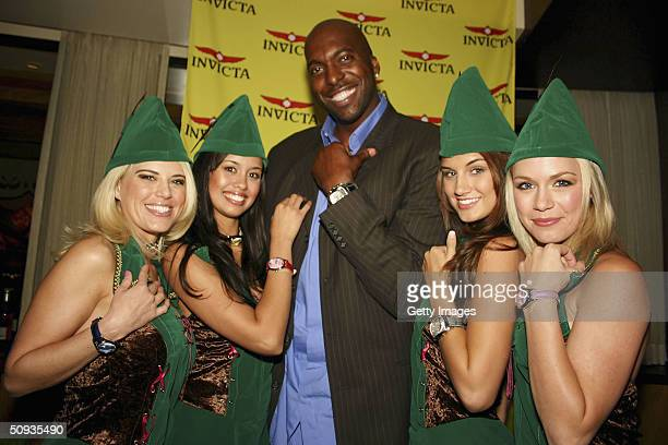 Best Agencey models Amy Miller Rachael Mortensen Andrea Tiede and Rachelle Leah pose with their Invicta watches with former NBA star John Salley on...