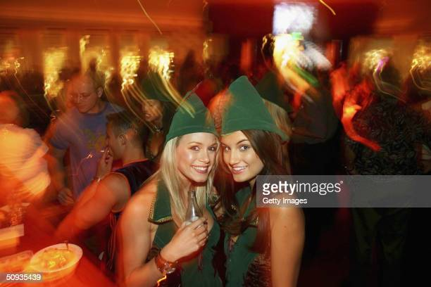 Best Agency models Rachelle Leah and Andrea Tiede pose in a festive lounge on June 5 2004 in Las Vegas Nevada