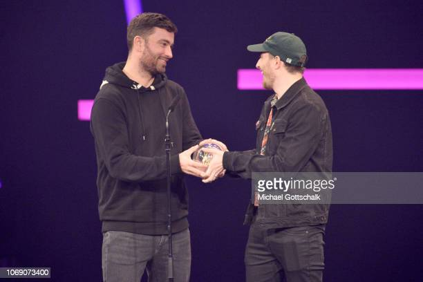 'Best Album' award winner Marteria and Casper speak on stage at the 1Live Krone radio award at Jahrhunderthalle on December 6 2018 in Bochum Germany