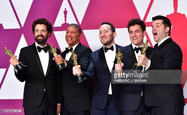 Best Animated Feature Film winners for SpiderMan Into the SpiderVerse Bob Persichetti Peter Ramsey Rodney Rothman Phil Lord and Christopher Miller...