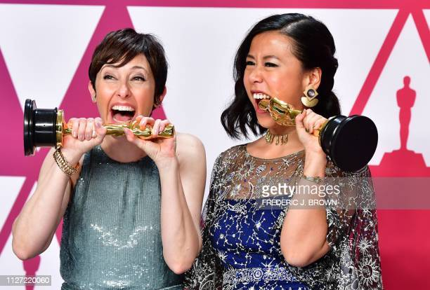 Best Animated Short Film winners for Bao Domee Shi and Becky NeimanCobb pose in the press room with their Oscars during the 91st Annual Academy...