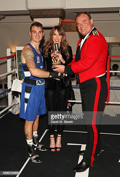 Best Boxer of the Evening Iain McCondichie Alex Jones and Col Mike Tanner attend the Royal Marines Boxing Bout at Cafe Royal in celebration of their...