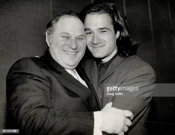 Best buddies Al Waxman puts a bear hug on Elias Koteas who's a best actor contender for Malarek Waxman who's a presenter at tonight's Genie Awards...