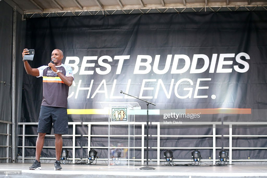 Best Buddies Global Ambassador Carl Lewis speaks onstage at the 100 mile start of the Walk, Run and Ride during Best Buddies Hearst Castle Challenge on September 12, 2015 in Carmel, California.