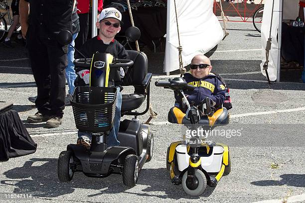 Best Buddy Alex O'Brien and Verne Troyer pose for a photo at the 2011 Audi Best Buddies Challenge on June 4 2011 in Hyannis Massachusetts