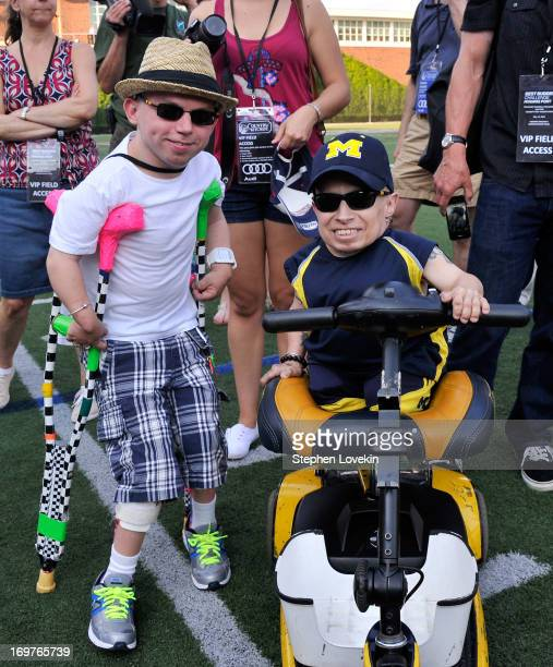 Best Buddy Alosha O'Brien and Actor Verne Troyer attend the Tom Brady Football Challenge for the Best Buddies Challenge Hyannis Port on May 31 2013...