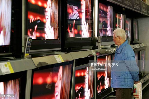 Best Buy customer looks at a display of flat panel televisions at a Best Buy store February 1 2007 in San Francisco Football fans have been...