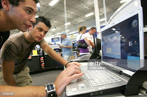 Best Buy customers Andre Vaz and Zoran Kostov test an HP laptop at a Best Buy store May 8 2007 in San Francisco California Computer maker...