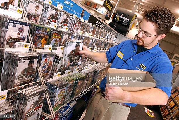 Best Buy employee Walter E Guenther restocks popular SEGA Sports video games such as Super Monkey Ball 2 and NBA 2K3 in anticipation of a busy...