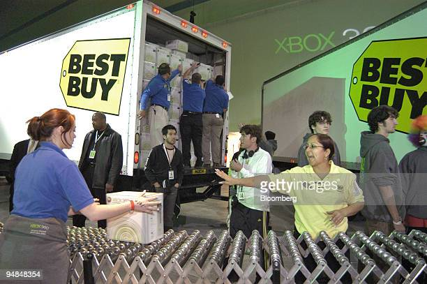 Best Buy employees roll out Microsoft Corp.'s new Xbox 360 video-game consoles to be distributed to customers at the Zero Hour event in Palmdale,...