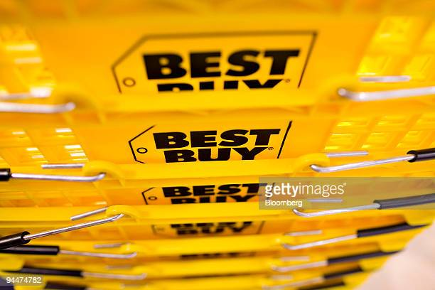 Best Buy logos appear on the side of shopping baskets at a Best Buy store in New York US on Tuesday Dec 15 2009 Best Buy Co the largest electronics...