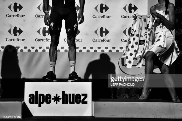 Best climber France's Julian Alaphilippe prepares to put on his jersey on the podium after the twelfth stage of the 105th edition of the Tour de...