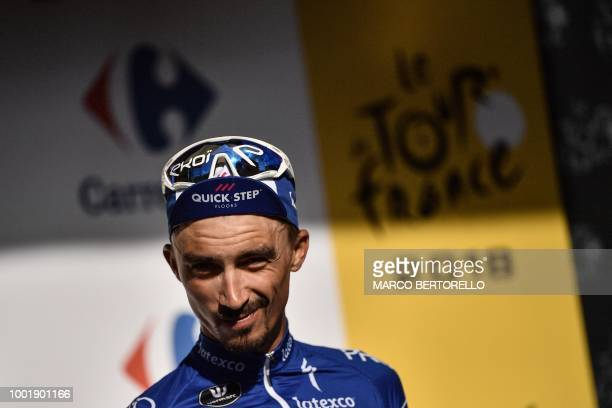 Best climber France's Julian Alaphilippe reacts on the podium after the twelfth stage of the 105th edition of the Tour de France cycling race between...