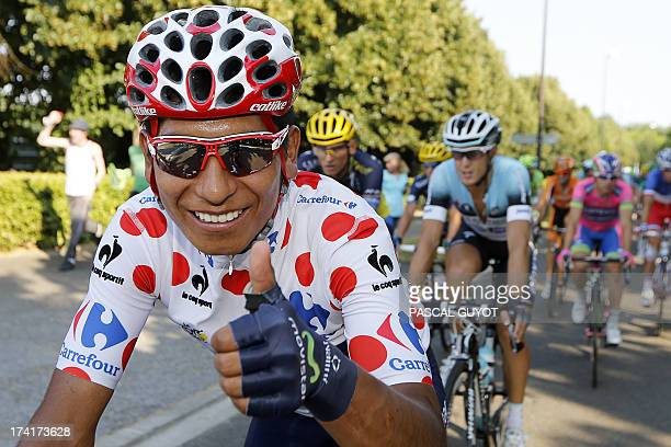 Best climber's polka dot jersey Colombia's Nairo Quintana thumbs up to celebrates his secondplaced in the overall standings as he rides during the...