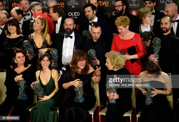 Best direction and best film awards winner Spanish film director Isabel Coixet talks with Spanish actress Marisa Paredes as they pose with the rest...