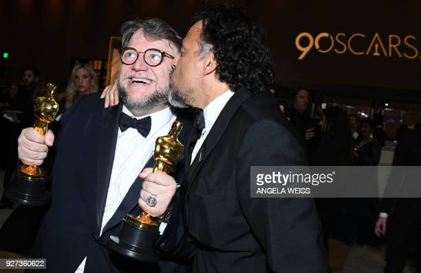 TOPSHOT Best Director and Best Film laureate Mexican director Guillermo del Toro and Mexican director Alejandro Gonzalez Inarritu attend the 90th...