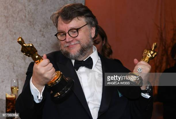 TOPSHOT Best Director and Best Film laureate Mexican director Guillermo del Toro stands at the engraving station as he attends the 90th Annual...