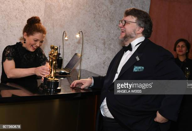 Best Director and Best Film laureate Mexican director Guillermo del Toro stands at the engraving station as he attends the 90th Annual Academy Awards...
