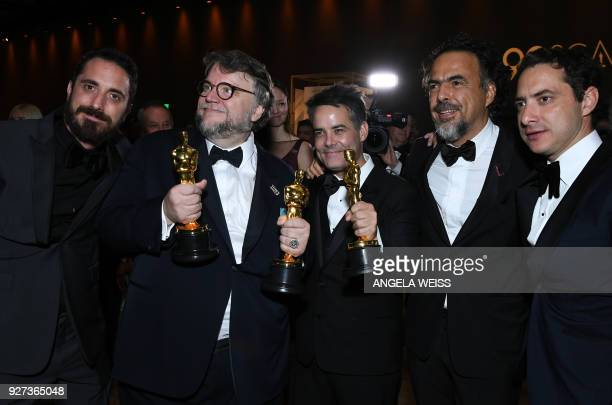 Best Director and Best Film laureate Mexican director Guillermo del Toro and Mexican director Alejandro Gonzalez Inarritu attend the 90th Annual...