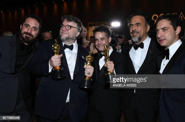Best Director and Best Film laureate Mexican director Guillermo del Toro and Mexican director Alejandro Gonzalez Inarritu attend the 90th Annual...
