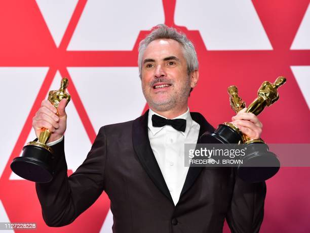 TOPSHOT Best Director Best Foreign Language Film and Best Cinematography winner for Roma Alfonso Cuaron poses in the press room with his Oscars...