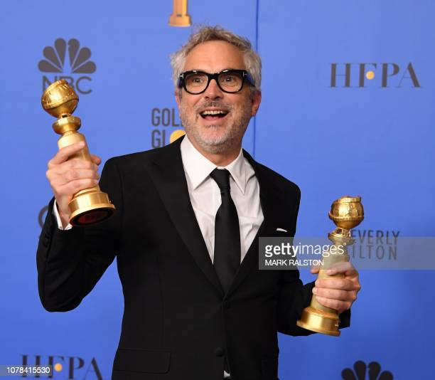 TOPSHOT Best Director Motion Picture and Best Motion Picture Foreign Language for 'Roma' winner Alfonso Cuaron poses with the trophy during the 76th...