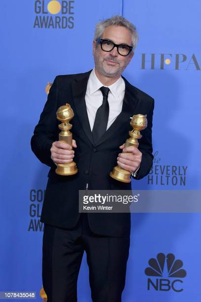 Best Director - Motion Picture - Roma - and Best Motion Picture - Foreign Language - Roma - winner Alfonso Cuarón poses poses in the press room...