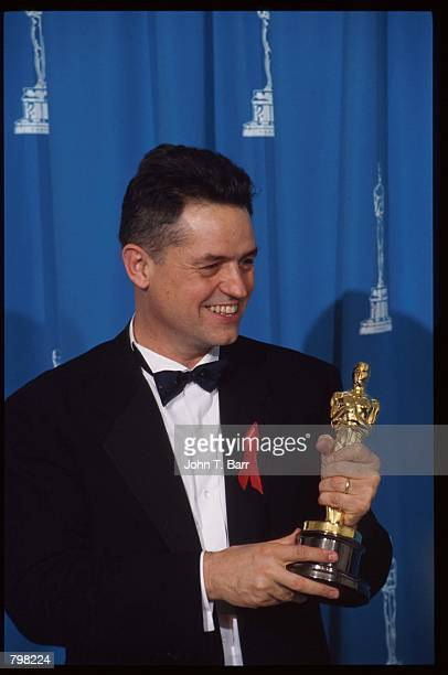 Best Director recipient Jonathan Demme holds his oscar at the 64th annual Academy Awards March 30 1992 in Los Angeles CA The Academy of Motion...