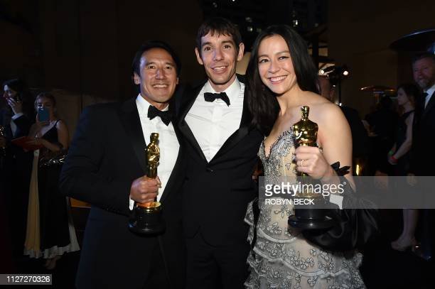 Best Documentary winner for Free Solo Elizabeth Chai Vasarhelyi Alex Honnold and Jimmy Chin attend the 91st Annual Academy Awards Governors Ball at...