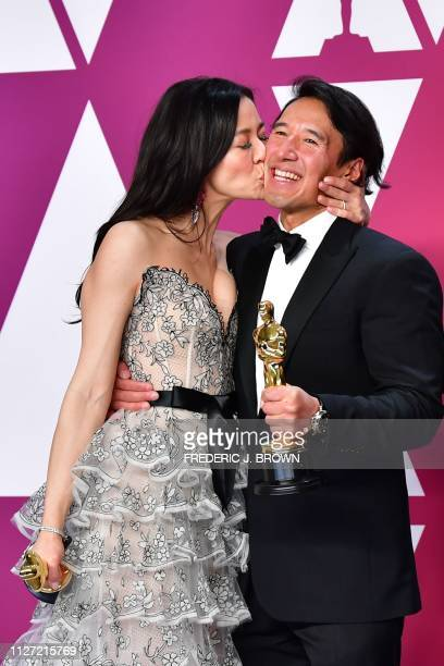 Best Documentary winners for Free Solo Elizabeth Chai Vasarhelyi and Jimmy Chin pose in the press room during the 91st Annual Academy Awards at the...