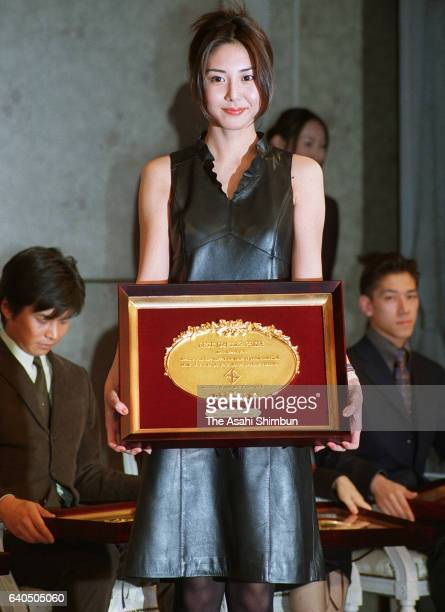 Best Dresser Award winner and actress Nanako Matsushima poses for photographs during the award ceremony on December 7 1999 in Tokyo Japan