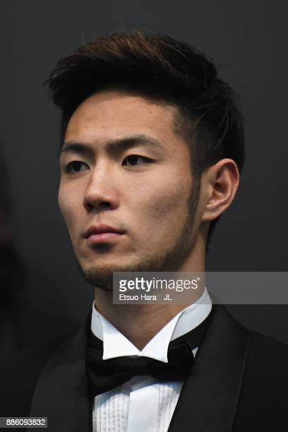 Best Eleven player Kenyu Sugimoto of Cerezo Osaka poses for photographs during a press conference after the 2017 JLeague Awards at Yokohama Arena on...