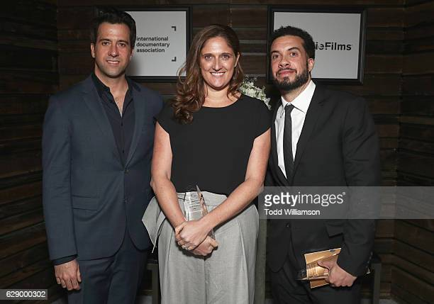 Best Feature award winners Ezra Edelman and Caroline Waterlow and presenter Troy Garity attend the 32nd Annual IDA Documentary Awards at Paramount...