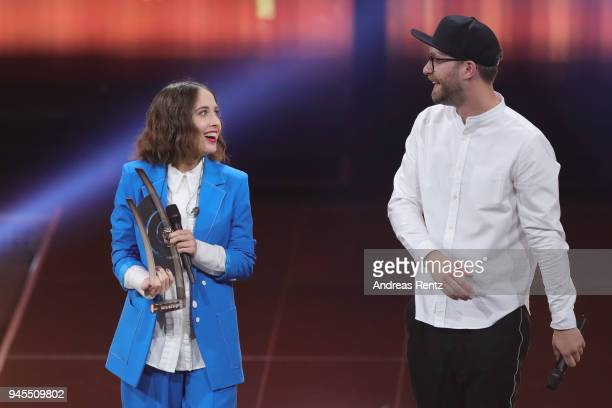 'Best Female Artist Pop National' Award winner Alice Merton and Marc Forster are seen on stage during the Echo Award show at Messe Berlin on April 12...