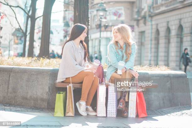 Best female friends chatting after shopping.