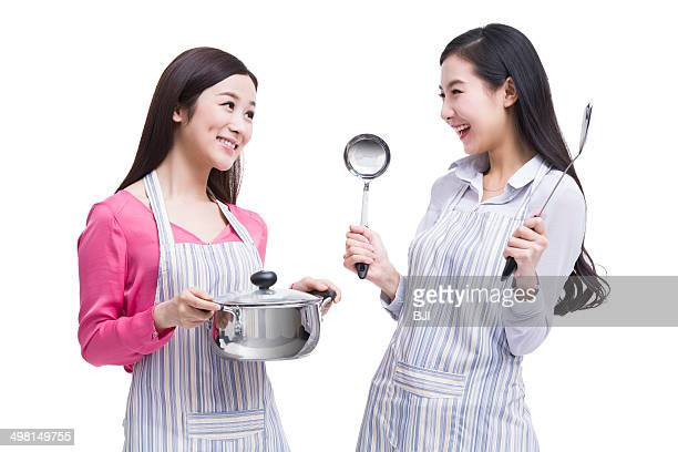 Best female friends doing cooking