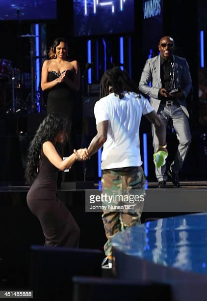 Best Female Hip Hop Artist Award Winner Nicki Minaj and Lil Wayne onstage during the BET AWARDS '14 at Nokia Theatre LA LIVE on June 29 2014 in Los...