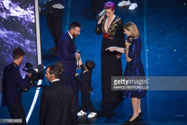 Best FIFA Men's Player of 2019, Argentina and Barcelona forward Lionel Messi , reacts with one of his children, as Best FIFA Women's Player of 2019,...
