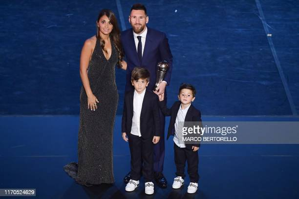 TOPSHOT Best FIFA Men's Player of 2019 Argentina and Barcelona forward Lionel Messi poses with his wife Antonella Roccuzzo Messi and their children...
