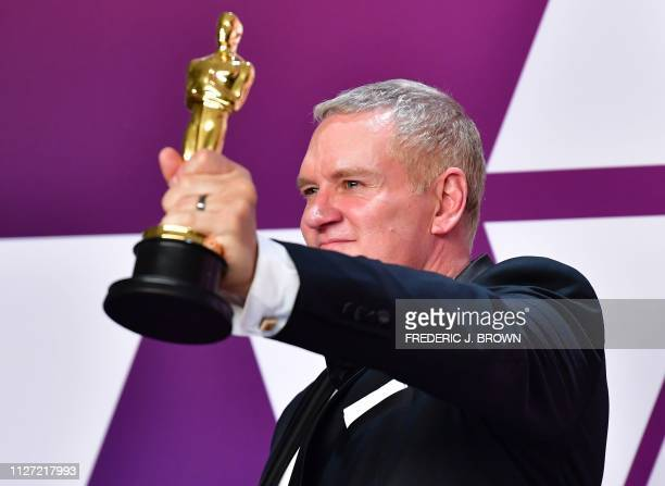 Best Film Editing winner for Bohemian Rhapsody John Ottman poses in the press room with the Oscar during the 91st Annual Academy Awards at the Dolby...